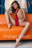 Irina J in Irina - Orange Couch gallery from STUNNING18 by Thierry Murrell